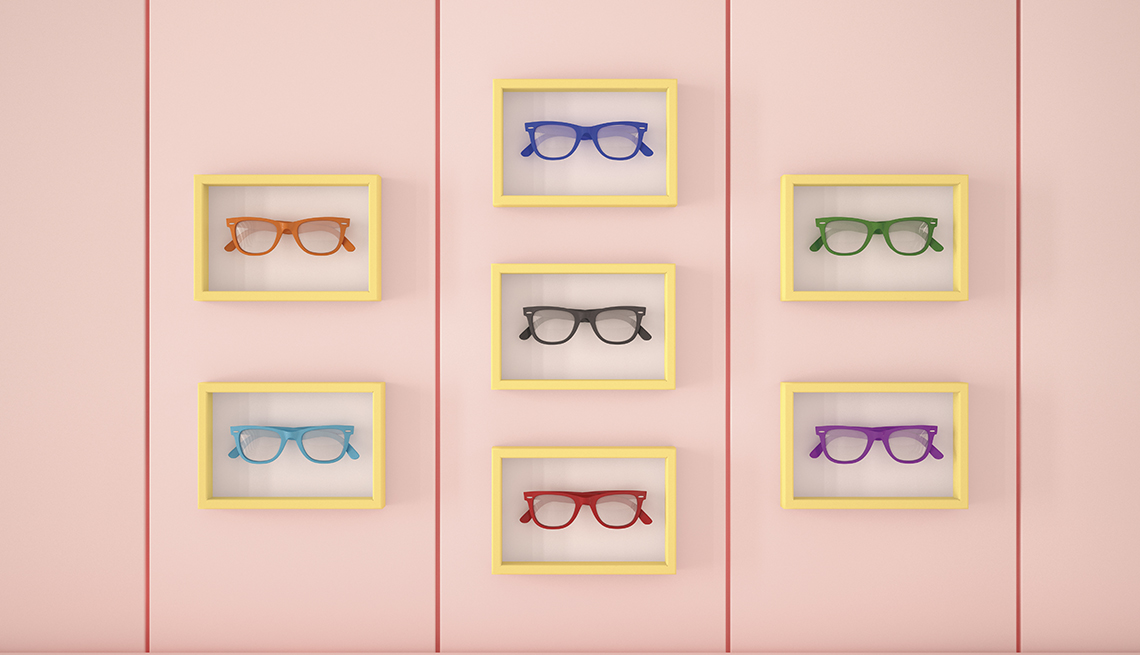 Eye glasses in picture frames against a wall