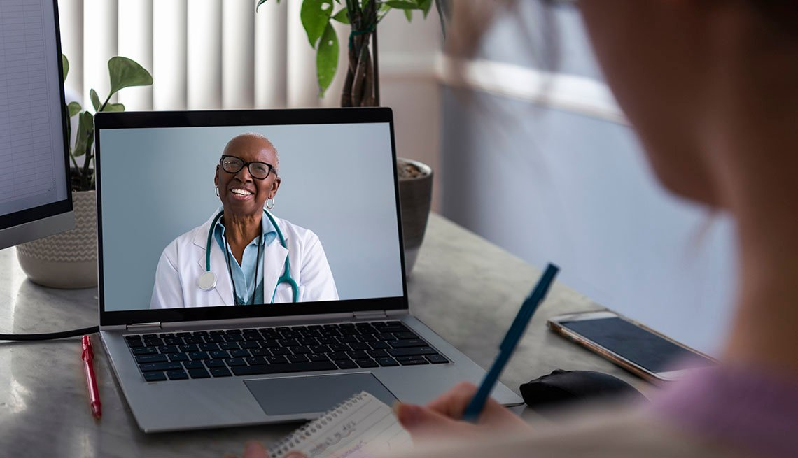 woman at telemedicine appointment talking to medical provider