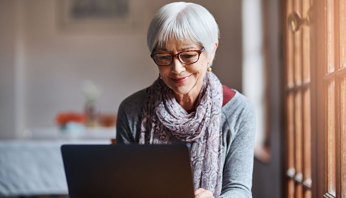 woman using a laptop in a retirement home