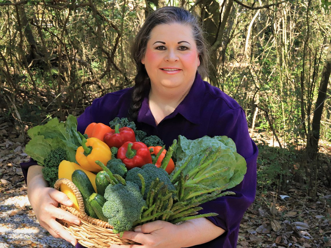 portrait of anita lesko carrying an armload of fresh produce