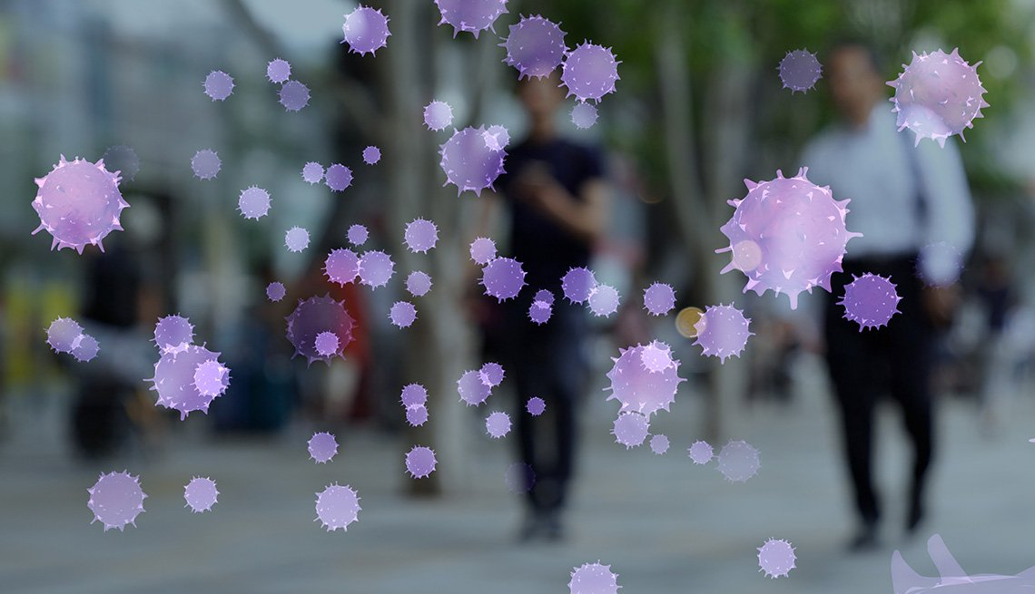 Images of virus floating in front of a blurry photograph of people walking