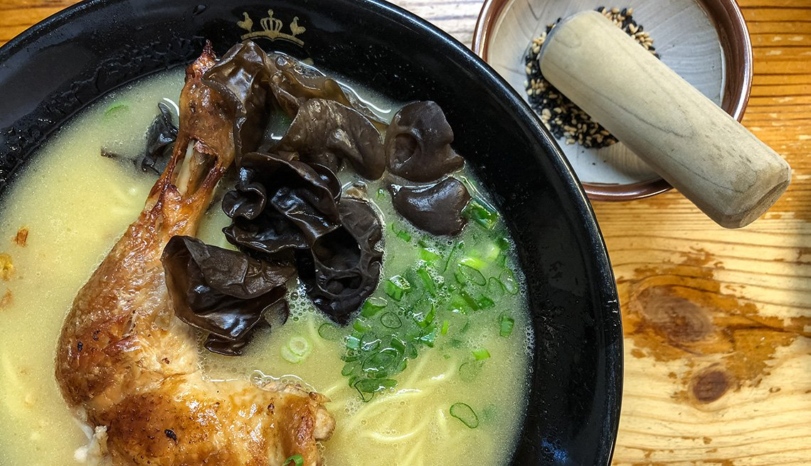 bowl of ramen noodles with mushrooms and chicken