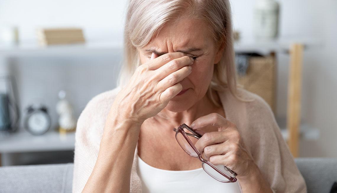 item 9 of Gallery image - woman rubs her eyes