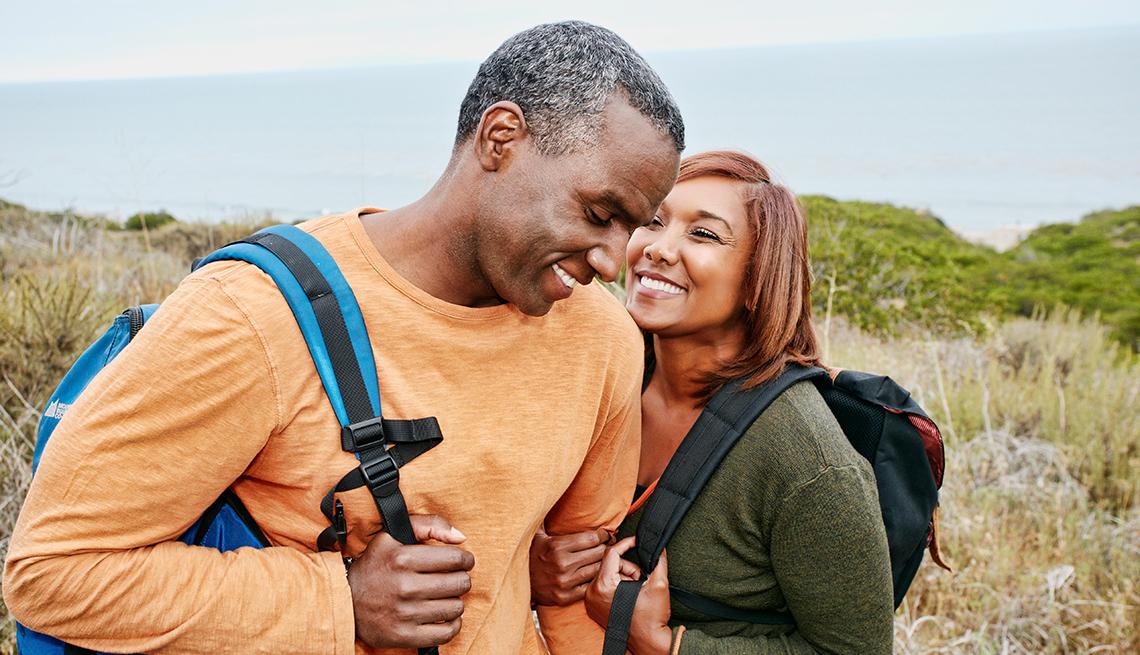 couple hiking on rural hillside
