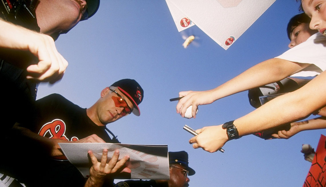 Shortstop Cal Ripken of the Baltimore Orioles signs autographs after a game in 1995