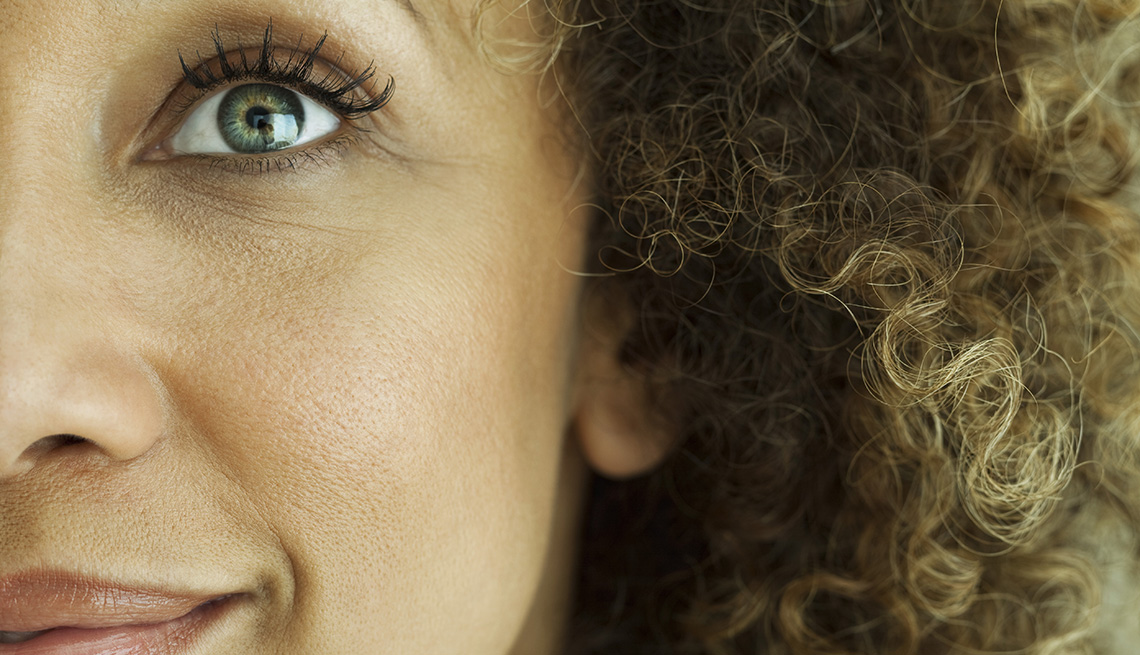 Close up of the side of a woman's face and her eye.