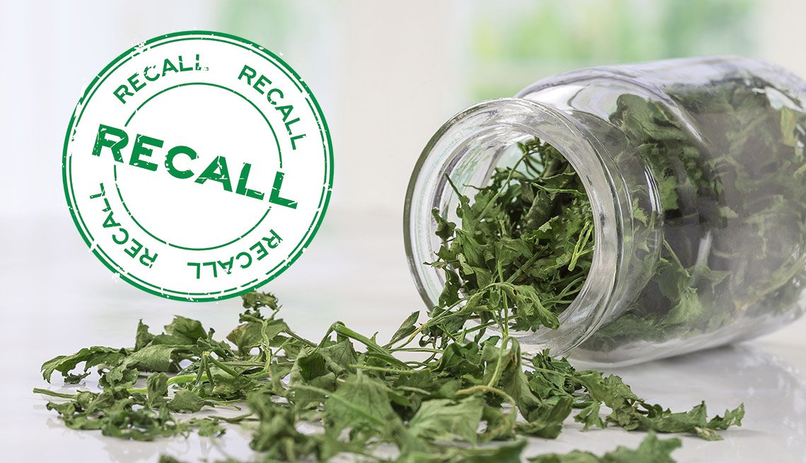 an opened jar of dried parsley sits next to a food safety type of recall sign
