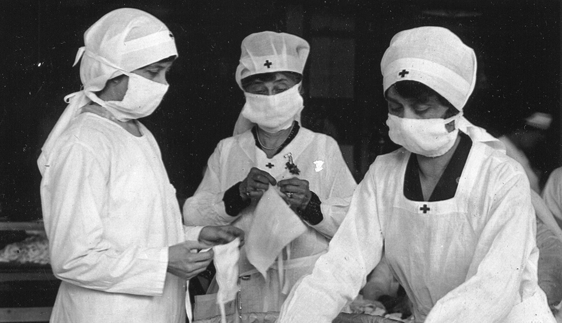 Red Cross workers removing bundles of masks for American soldiers in Boston, Massachusetts, 1918.