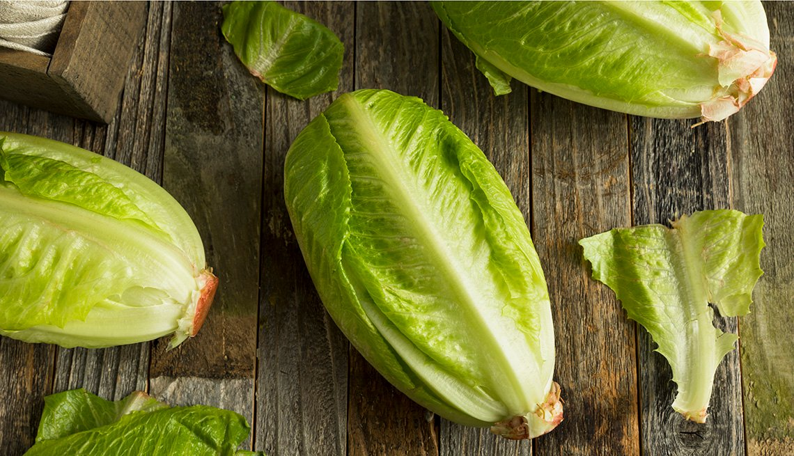 Hearts of romaine lettuce on a wood table
