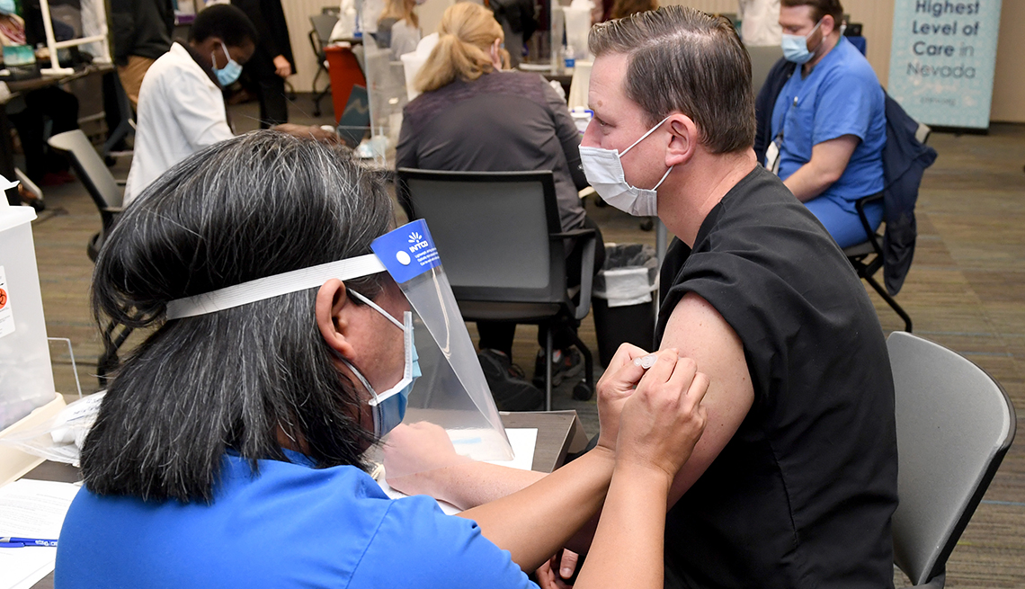 A medical provider receives a Pfizer-BioNTech COVID-19 vaccination. (Photo by Ethan Miller/Getty Images)