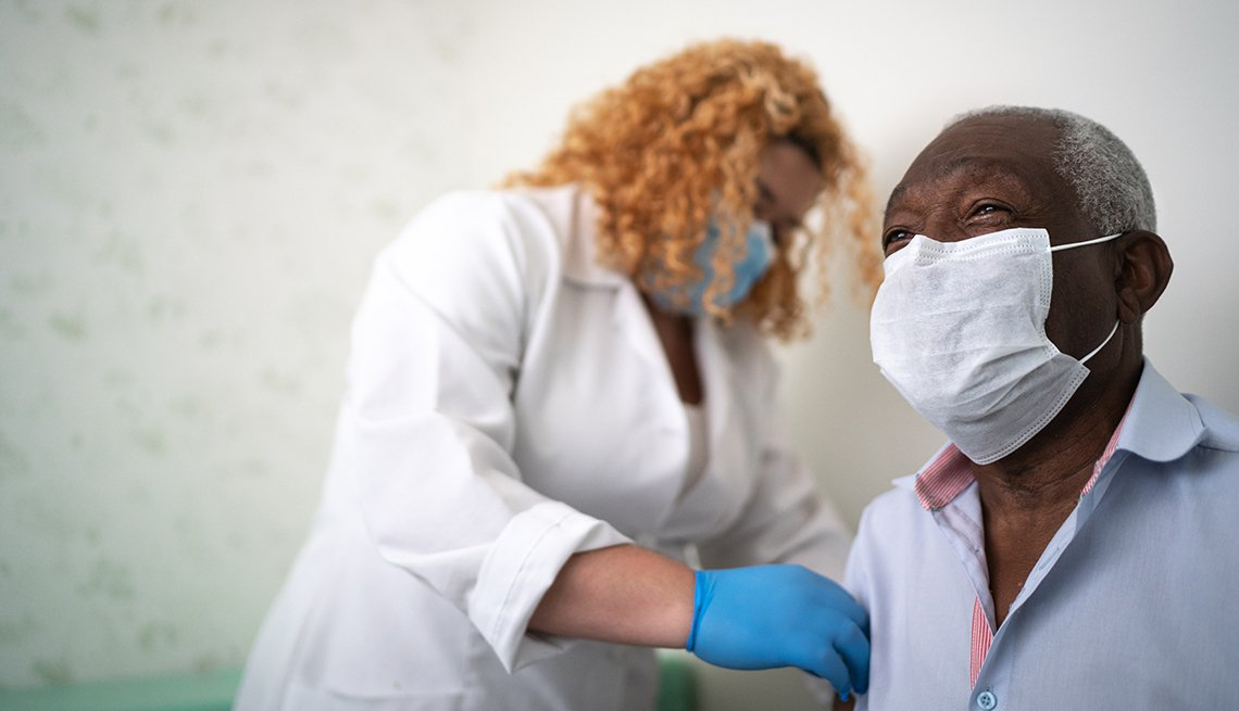 Medical provider gives a man a vaccine