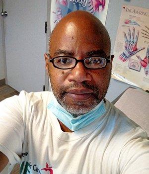 eduardo rollox takes a selfie inside a doctor exam room