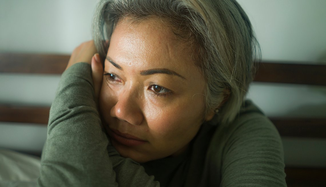 Woman looking depressed, leaning her head on her arm