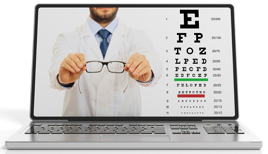 An eyesight test and a doctor holding prescription eyeglasses n a laptop's screen