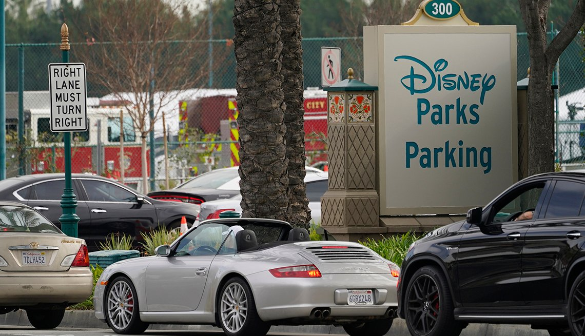 item 2 of Gallery image - cars lined up at a covid vaccination site in the disneyland parking lot in anahiem california