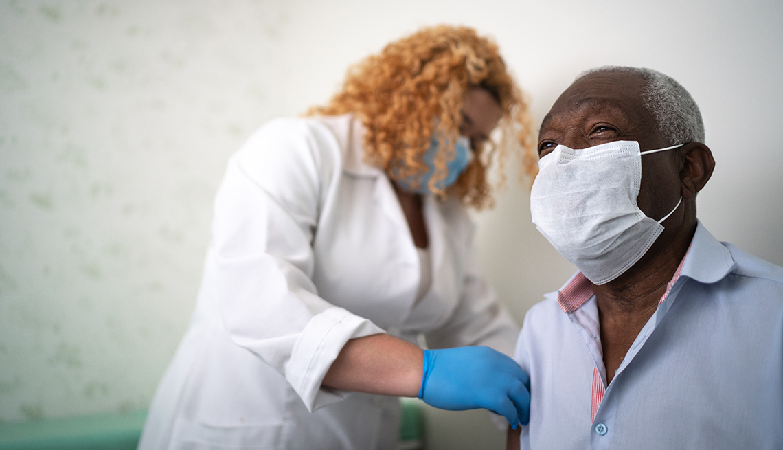 Nurse taking blood from an African American man