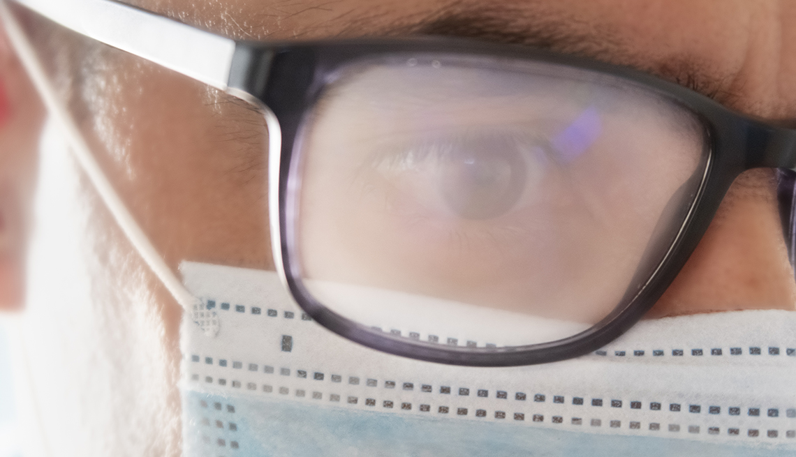 Man wearing glass that are fogged up due to a face mask.
