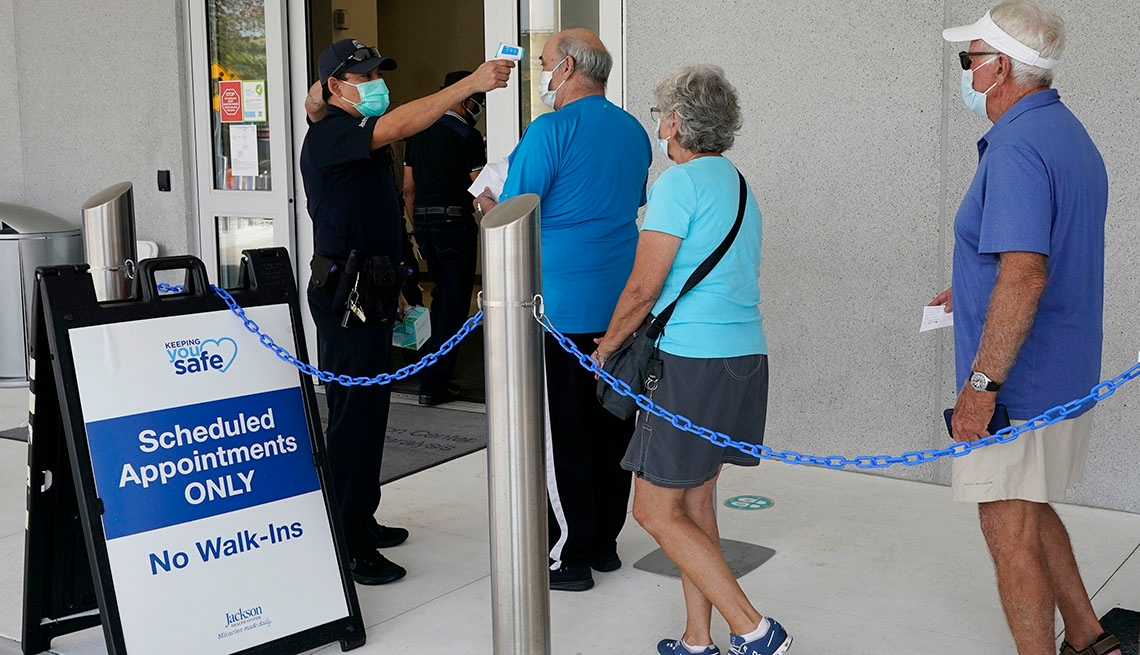 Older adults wait in line at a COVID vaccination center