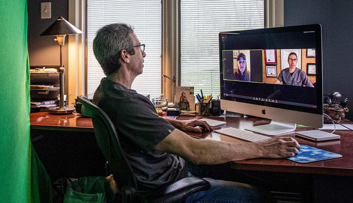 man at his home computer on a telemedicine call