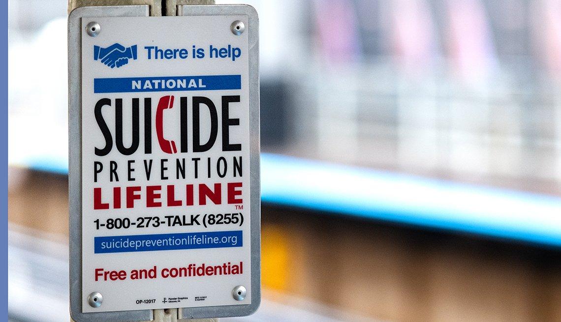 Un letrero que anuncia el número telefónico de la línea para prevenir el suicidio