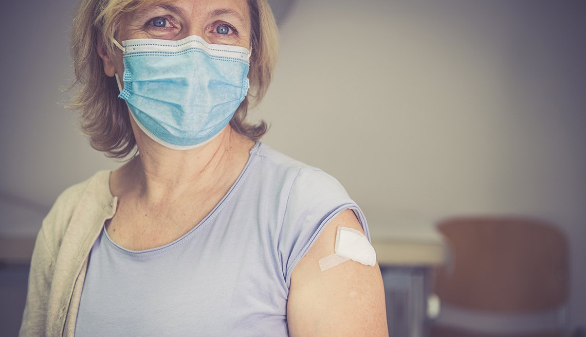 Woman who has just been vaccinated, wearing a face mask