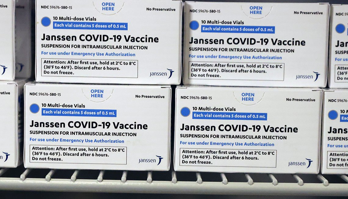 Boxes of Johnson & Johnson COVID-19 vaccine sits in a refrigerator