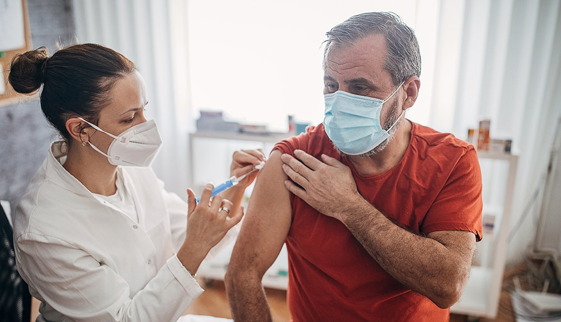 Older man getting the COVID-19 vaccine