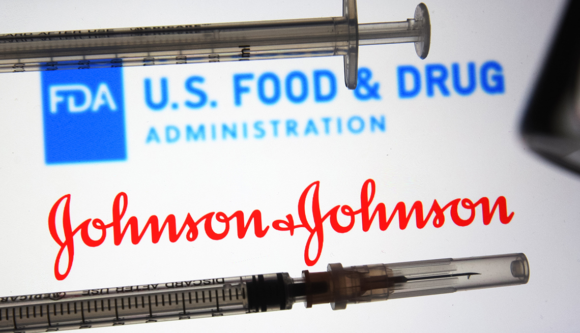Vaccine syringes in front of logos of the U.S. FDA and Johnson and Johnson.
