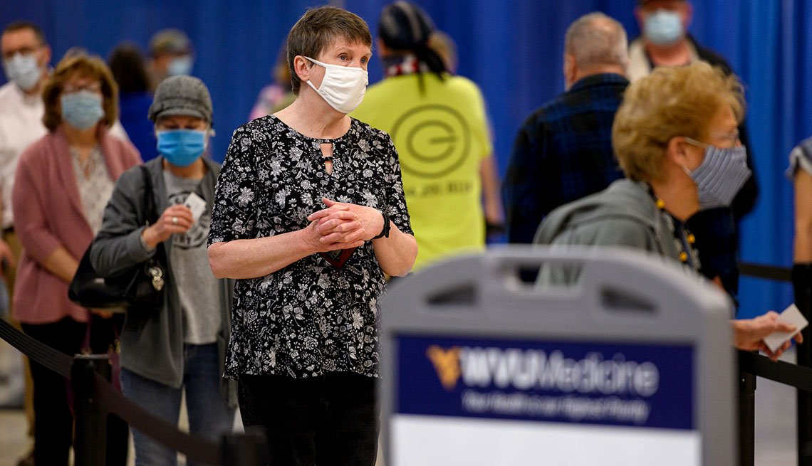 Residents wear protective masks while waiting to be vaccinated at a West Virginia United Health System Covid-19 vaccine clinic