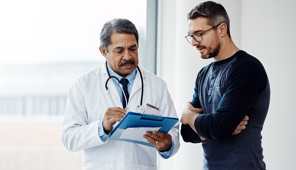 A man is talking to a doctor
