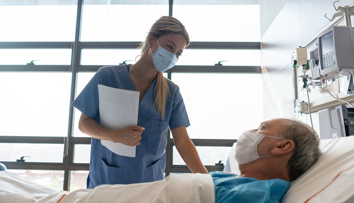 Nurse and patient wearing mask in hospital