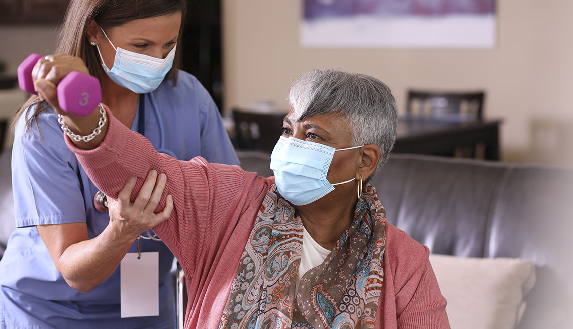 masked physical therapy patient and health care provider