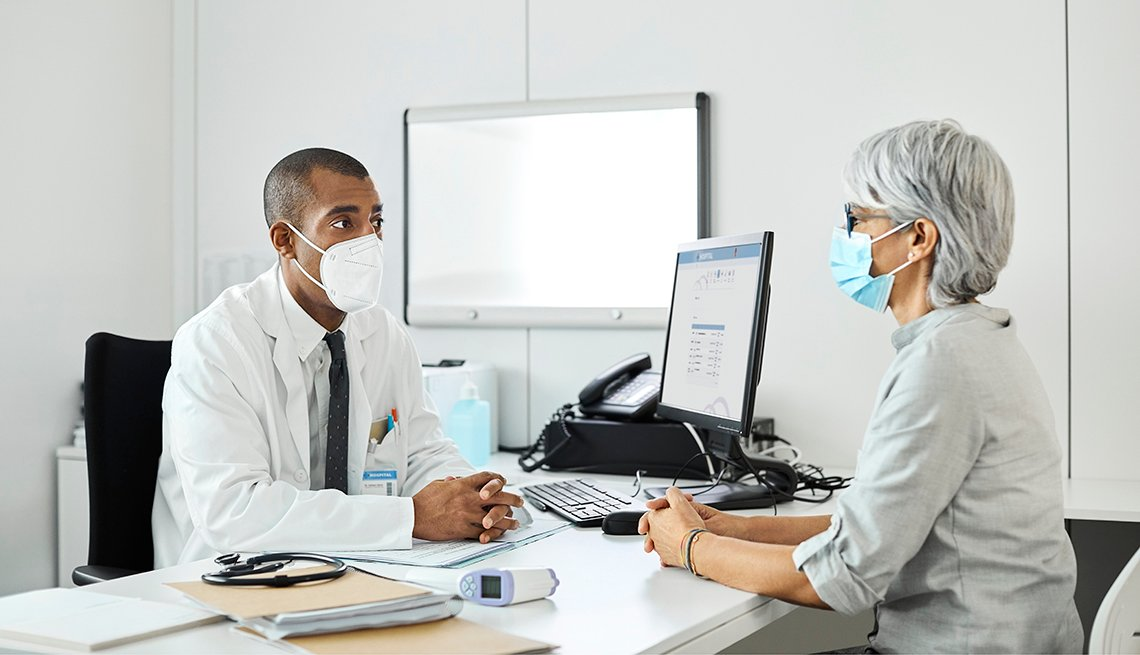 doctor discussing covid-19 with a female patient