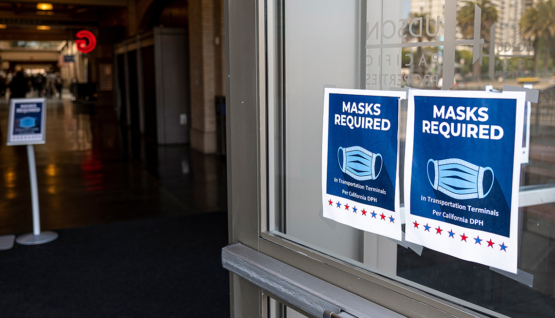 Signs inform visitors that masks are required inside the Ferry Building in San Francisco, California, U.S., on Monday, July 19, 2021.