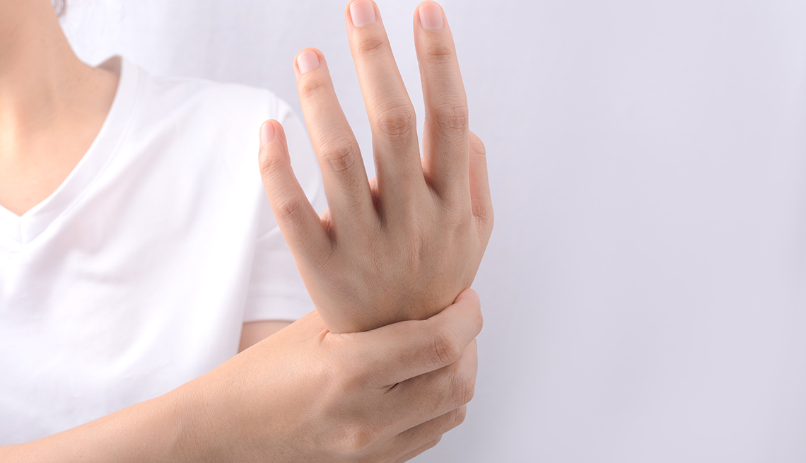 woman holding her wrist due to numbness