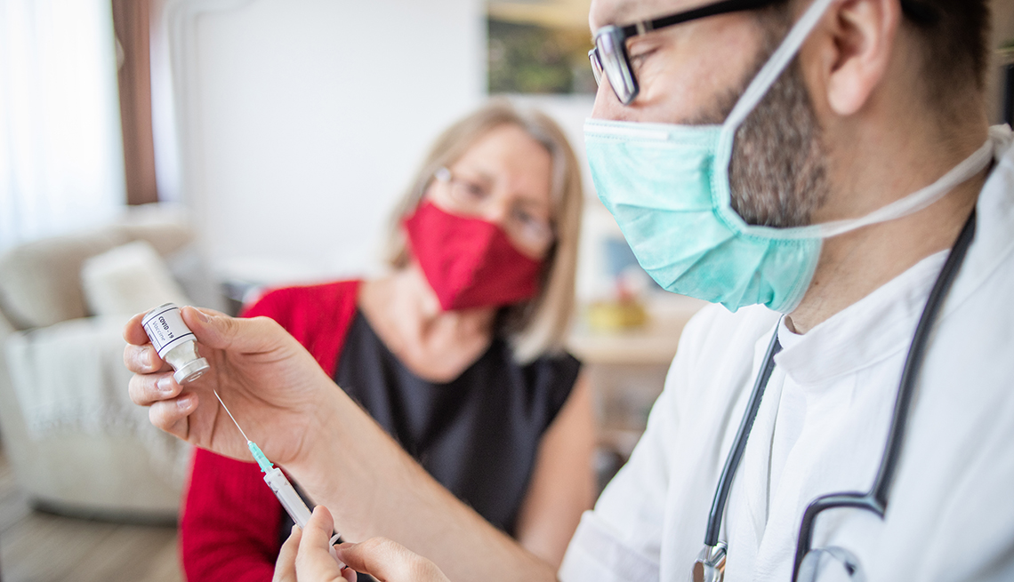 woman in a doctor's office about to get her vaccine booster