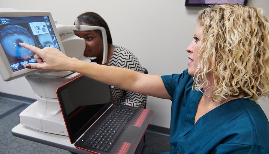 a woman demonstrates a computer program that detects eye disease
