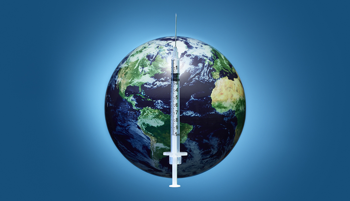 a hypodermic needle like the ones that give vaccines superimposed over an image of the earth
