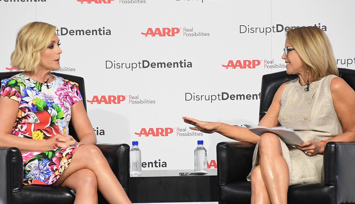 Actress Jane Krakowski sitting across from interviewer Katie Couric. Backdrop says: AARP: Disrupt Dementia.