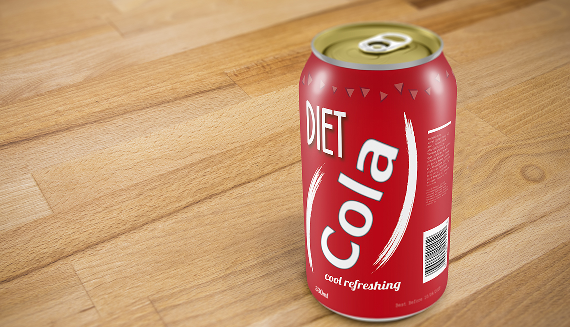 A generic can of diet cola on a wooden table.