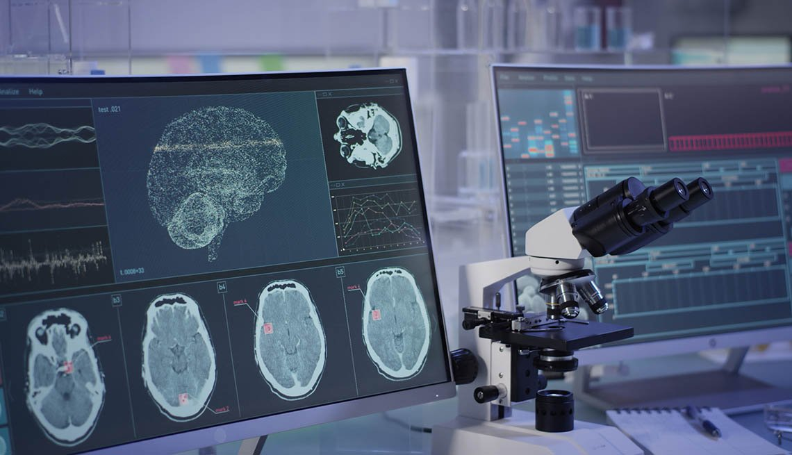 Research lab with brain scans and microscope