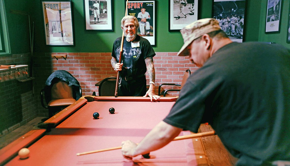 James Gibavitch plays pool in a bar designed to mimic the 1950s.