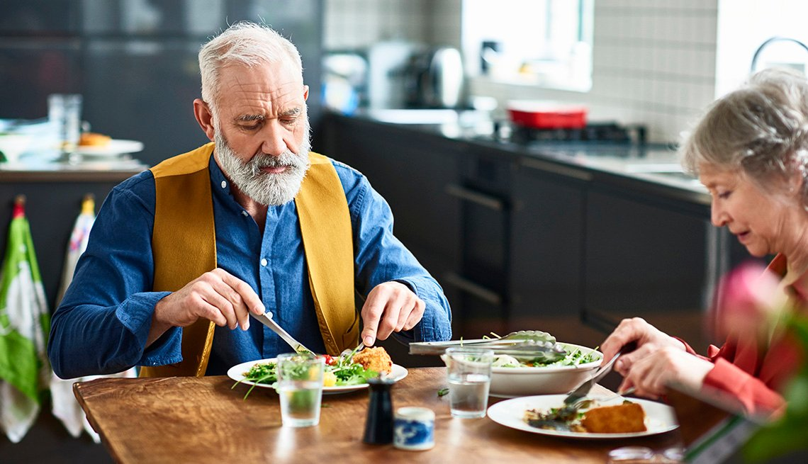 Older couple eating meal