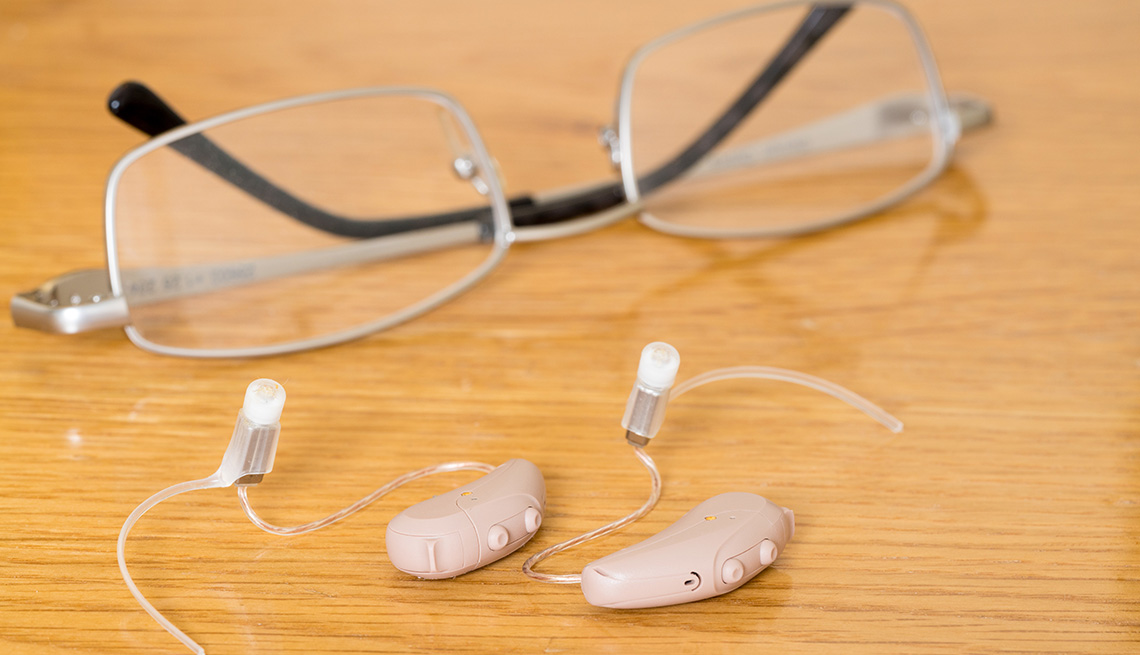 Glasses and hearing aid