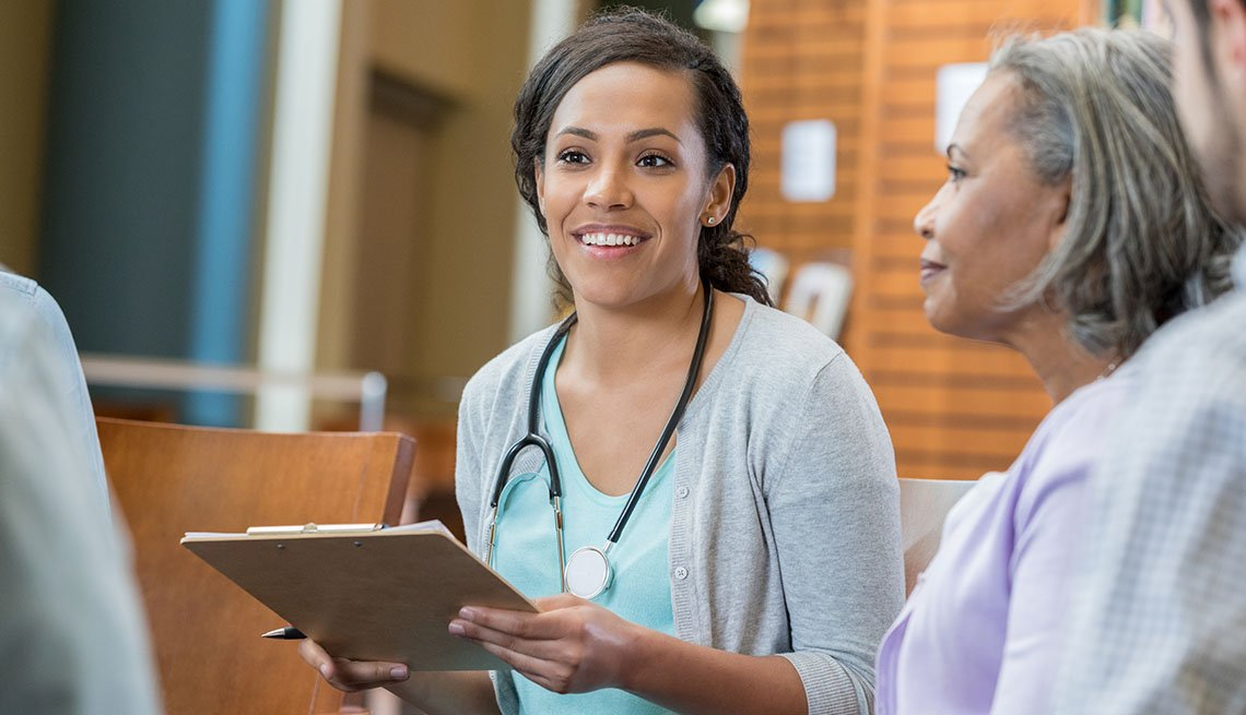 973984538African American healthcare professional talks with a female patient.