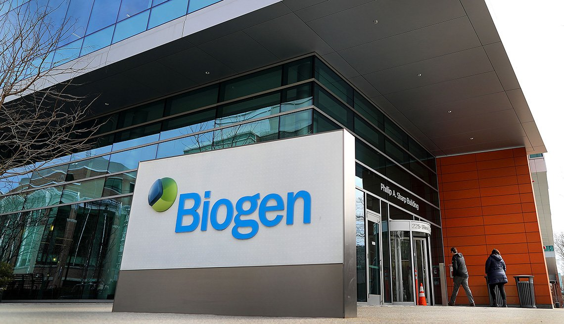 biotechnology company biogen sign in front of glass office building