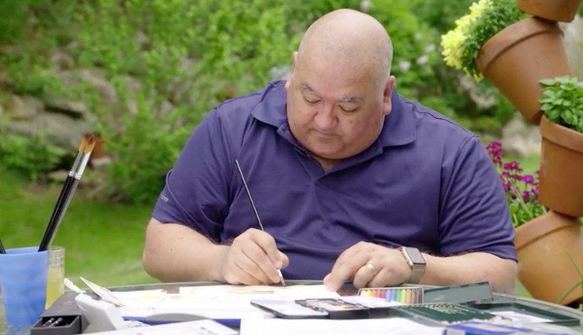 Man diagnosed with dementia painting in his backyard