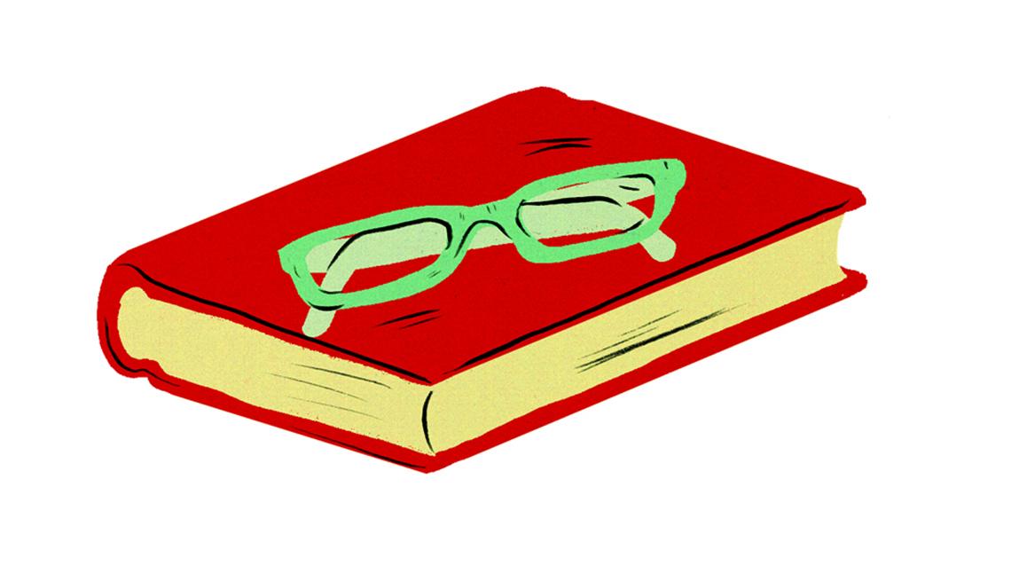 Libro con unos lentes encima.