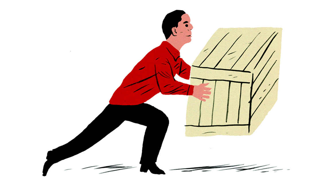 Hombre levantando una caja.
