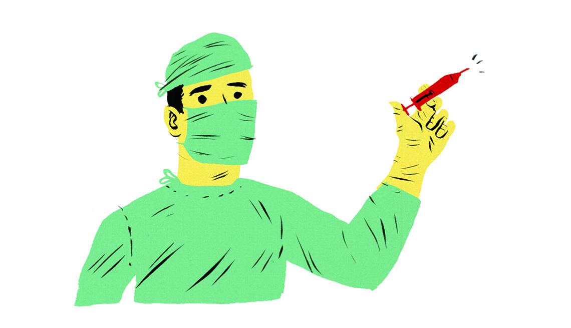 Cirujano con una jeringuilla